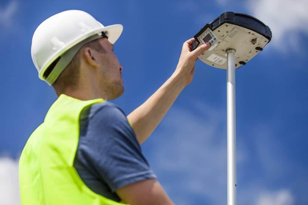 Land surveyor working with a GPS unit