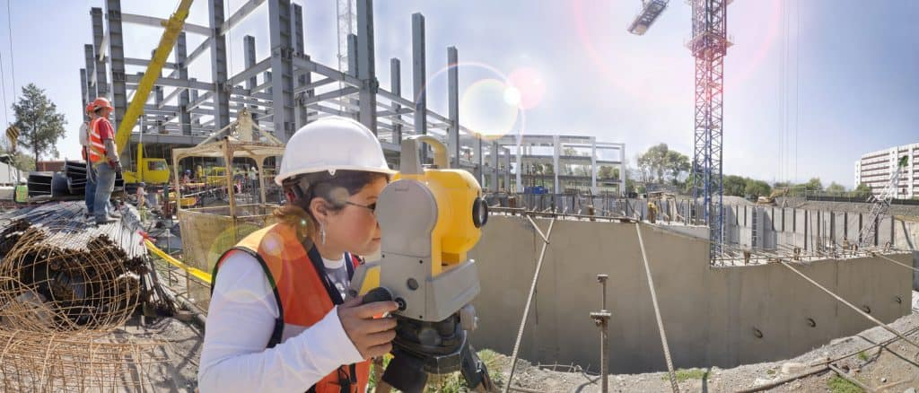 Topographical survey engineer in a building project